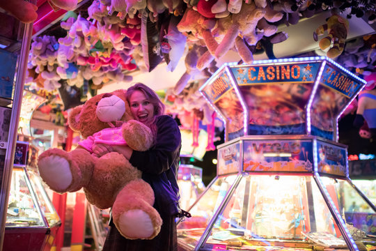Happy woman with gained teddy bear