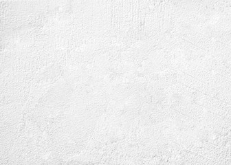 White cement texture plastered stucco wall painted fade background.