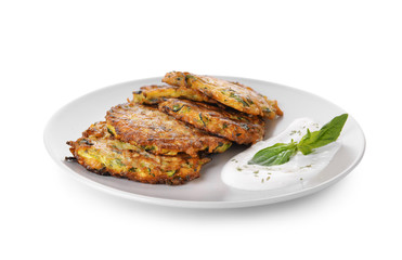 Plate with tasty zucchini pancakes on white background