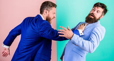 Business competition and confrontation. Domination and subordination. Hostile situation between opposing colleagues. Business partners competitors office colleagues tense faces conflict situation
