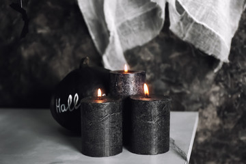 Burning candles as decor for Halloween party on table