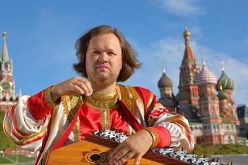 Musician playing an old Russian musical instrument gusli