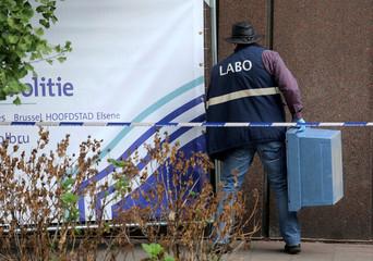An investigator walks near the Park Maximilien in Brussels