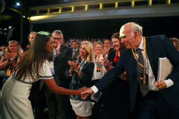 Anti-Brexit campaigner Gina Miller shakes hands with Liberal Democrats leader Vince Cable at the Liberal Democrats Conference in Brighton