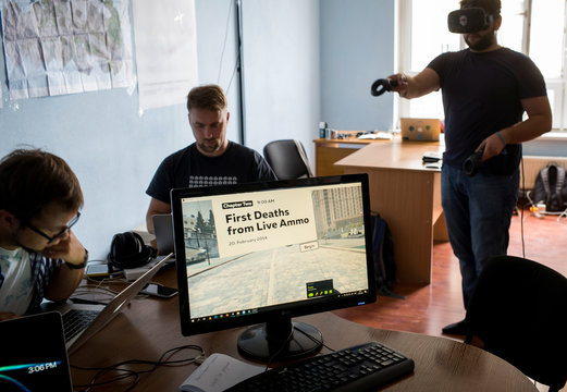 A co-founder of the New Cave Media Polezhaka and his staff members test a simulator of virtual reality in his office in Kiev
