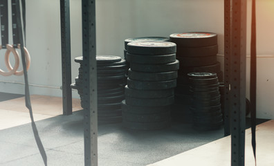 Different weight equipment in the gym. Crossfit, weightlifting or functional training.