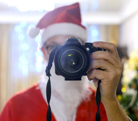 Portrait Santa takes pictures with  DSLR camera