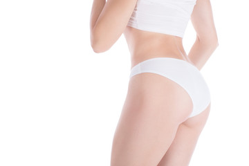 Female cropped fit body and buttocks in white panties and top, isolated on white.