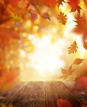 Autumn Falling Leaves and Wooden Table