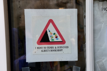 "A sign on display outside the Cofian bookshop, known locally as ""Albie's bookshop"", in Tenby, Pembrokeshire, Wales"