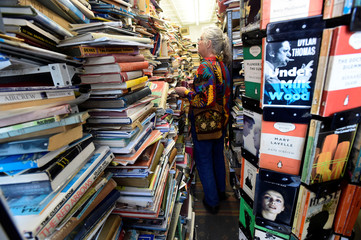 "A customer looks at the books on sale inside the Cofian bookshop, known locally as ""Albie's bookshop"", in Tenby, Pembrokeshire, Wales"