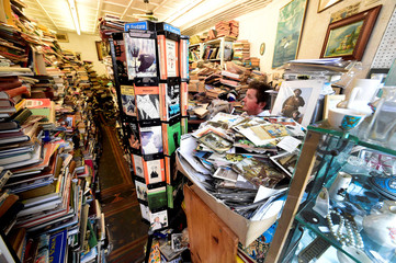 "Bookshop assistant Howard Rawson-Humphries watches over the books on sale inside the Cofian bookshop, known locally as ""Albie's bookshop"", in Tenby, Pembrokeshire, Wales"