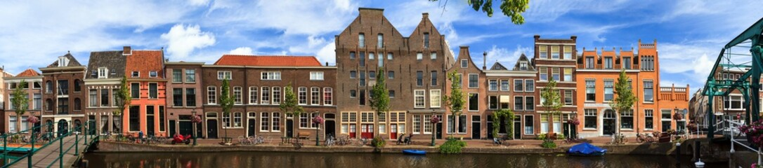Fototapeta Beautiful Linear panorama of the Oude Rijn canal cityscape in Leiden, The Netherlands, in summer
