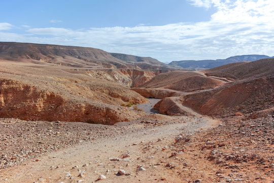 Dirt road in desert Negev, Israel,  transport infrastructure in desert, scenic mountains route from Eilat to north of Israel