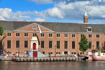 Facade of museum the Hermitage at the river Amstel in Amsterdam, the Netherlands, on a sunny summer day, on June 30, 2014