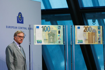 Yves Mersch, member of the Executive Board of the European Central Bank (ECB) presents the new 100- and 200-euro banknotes at the ECB headquarters in Frankfurt