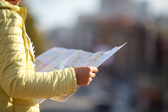 holding map paper with finding location for travel