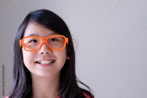 0ac3aded6246 Portrait of Asian teenager girl with big purple glasses