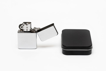 metal cigarette lighter with a black box on a white background close-up