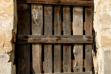 old fence of boards in the aperture