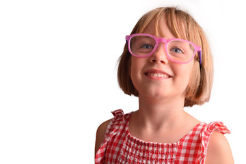 Smiling girl with large and round glasses looking