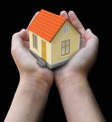 House in hands. Image with clipping path