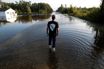 A member of The Cajun Navy navigates flood waters before attempting to cross a flooded road with a vehicle after Tropical Storm Florence caused flash floods in Dillon