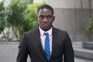 serious and confident african or black businessman; portrait of confident, successful african or black business man, manager, business executive CEO; young adult african man model