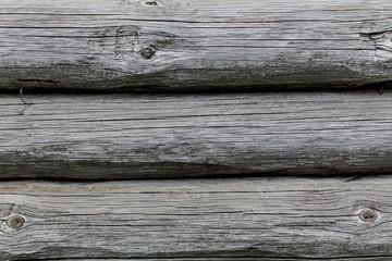 Wooden texture of round logs gray grunge texture