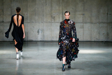 Models present creations at the Christopher Kane catwalk show at the Tate Modern during London Fashions Week Women's in London