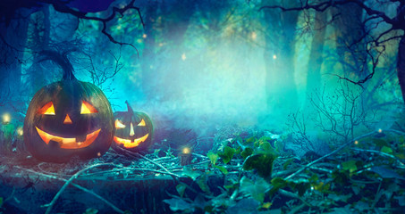 Halloween theme with pumpkins and dark forest.  Halloween design