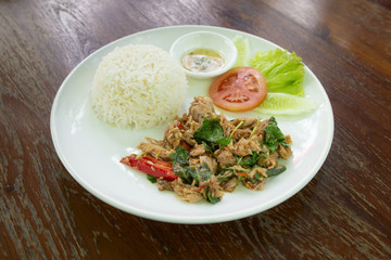 Tuna fried with basil and Cooked rice. Thai Food.