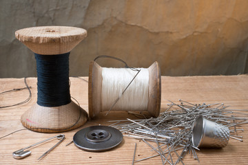 Two spools of thread with thimble