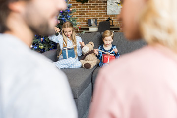 happy parents and cute children in pajamas holding christmas ... 183901c1c