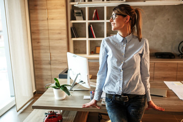 Portrait of mid age business woman.She standing in her office .