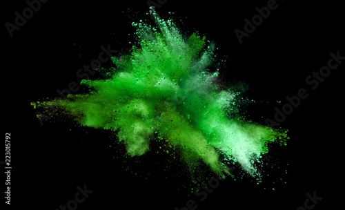 Fototapete Explosion of coloured powder on black background.