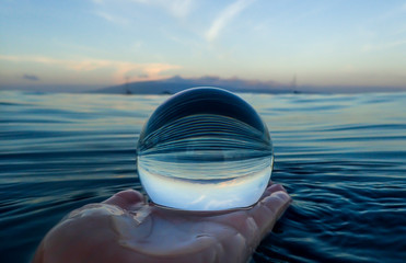 Blue Ripples on Ocean Surface Captured in Glass Ball