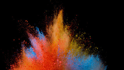 Explosion of coloured powder on black background.