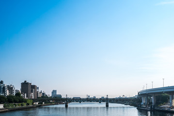 TOKYO, JAPAN - June 22, 2018: Tokyo Railway bridge and blue sky.