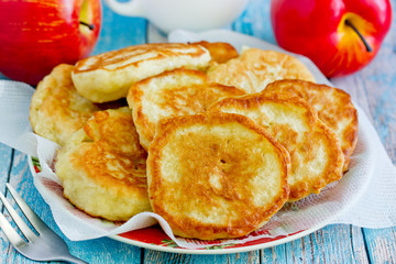 Sweet apple pancakes on plate close up