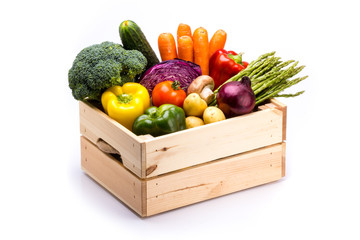 Wall Murals Vegetables Pine box full of colorful fresh vegetables on a white background