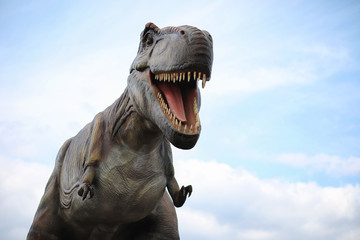 Fototapeta premium Park dinozaurów. Dinozaur na tle przyrody. Zabawka d