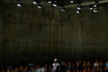 A model presents creations at the Christopher Kane catwalk show at the Tate Modern during London Fashions Week Women's in London