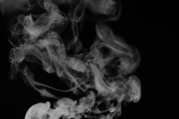 White smoke on a black background. Texture of smoke. Clubs of wh