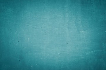 Texture of cracked turquoise paint on old metal