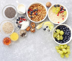 Breakfast food table. Plant based breakfast or brunch set, meal variety with  overnight oats, granola , fresh berries and various of topping. Overhead view, copy space