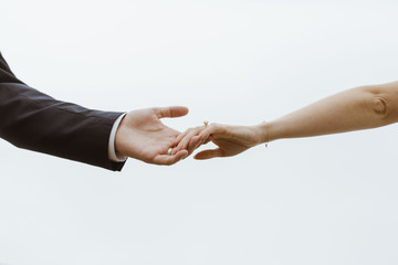 Man and Woman holding hands after marriage
