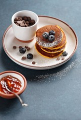Pumpkin pancakes with chocolate chips and fresh blueberry.