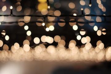 Blurred Christmas lights. Christmas garland on the window