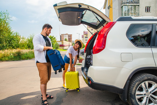 car travel concept. opened trunk with luggage inside woman with